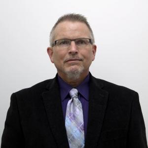 Dr Bruce A Johnson, PhD, MBA